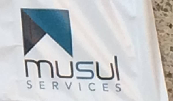 MUSUL Services logo on a banner