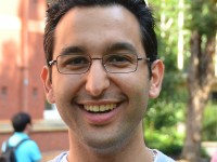 Photograph of Graduate Student Association President Sina Khatami smiling
