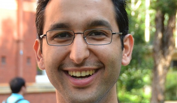 Photograph of Graduate Student Association President Sina Khatami smiling
